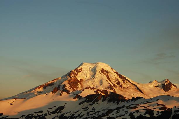 mountain frontlit at sunset stock photo