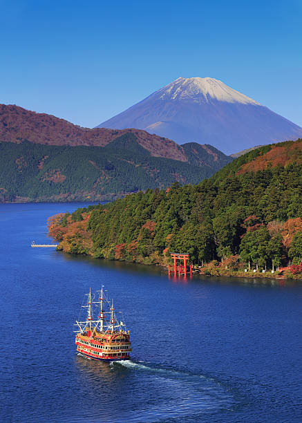 Mountain Fuji and Lake Ashi with Hakone Temple Mountain Fuji and Lake Ashi with Hakone temple and sightseeing cruise boat in autumn torii gate stock pictures, royalty-free photos & images