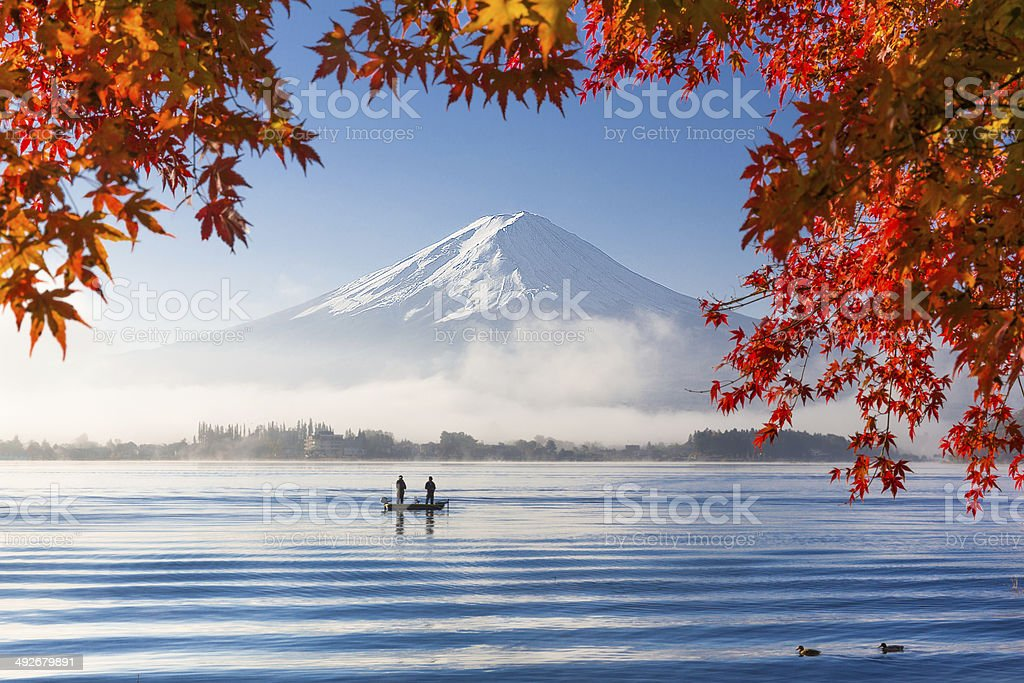 Mountain Fuji and lake with morning fog in autumn season stock photo