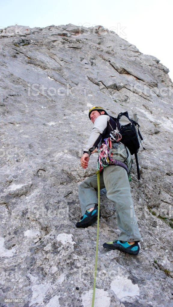 mountain guide at the start of a steep climbing route in the Swiss Alps zbiór zdjęć royalty-free