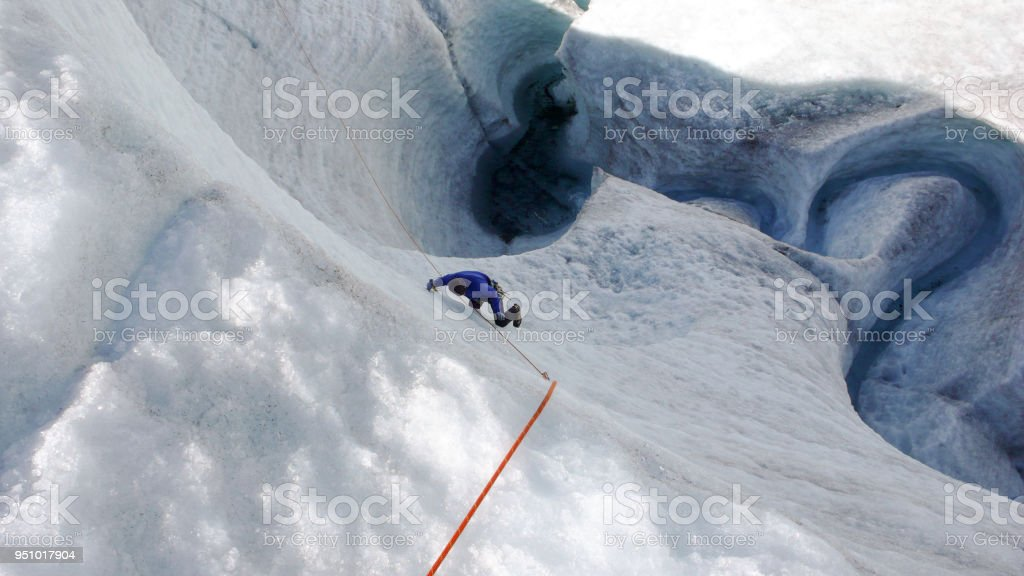 A Mountain Guide Candidate Training Ice Axe And Rope Skills On A