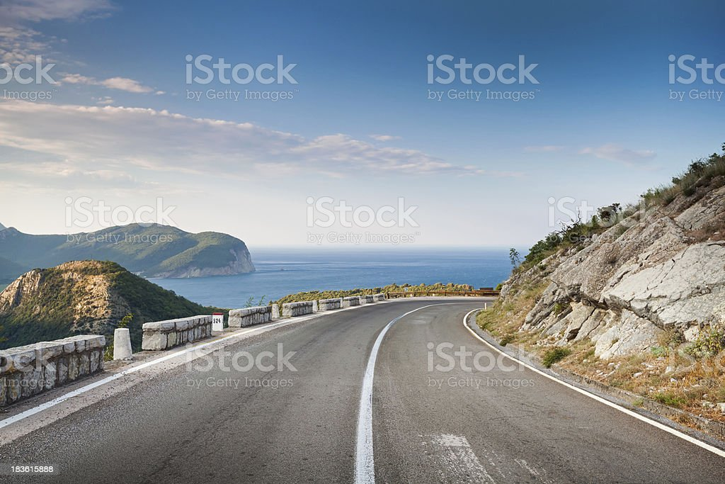 Mountain highway with blue sky and sea on a background stock photo