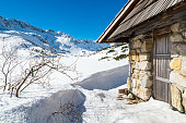 Traditional wooden houses at mountain in snowy day