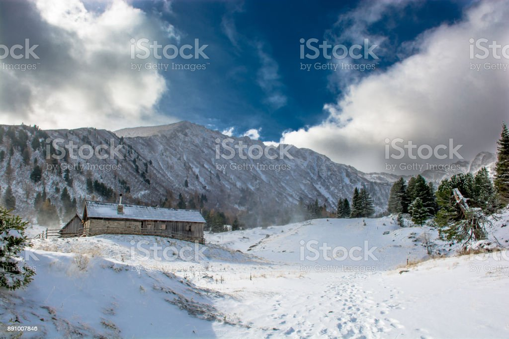 Mountain Hut with Snow between High Mountains in Winter in Austria stock photo