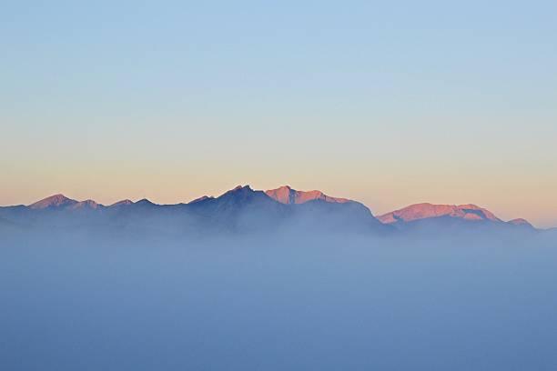 Mountain in the mist stock photo