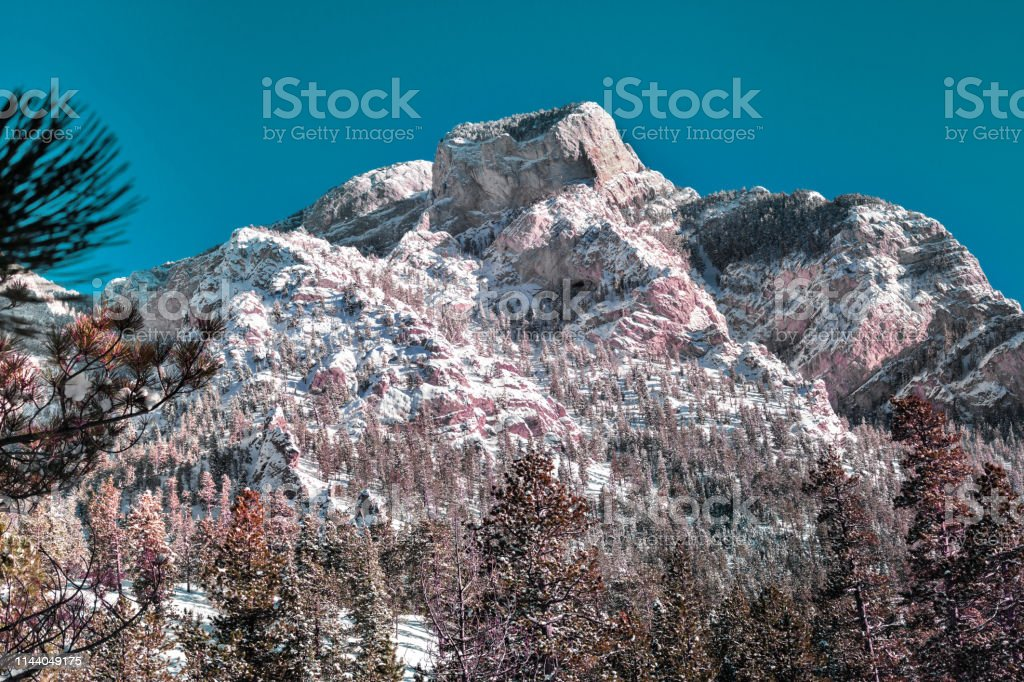 Mountain in the winter against a blue sky, landscape in USA stock photo