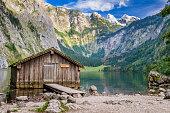 istock Mountain lake fishing hut surrounded high mountain-range 174787016