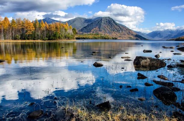 Mountain lake Froliha with stones and reflection, near lake Baikal stock photo