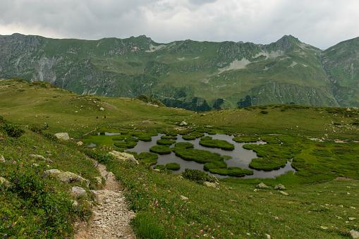 istock Mountain lake in Abkhazia 911352826