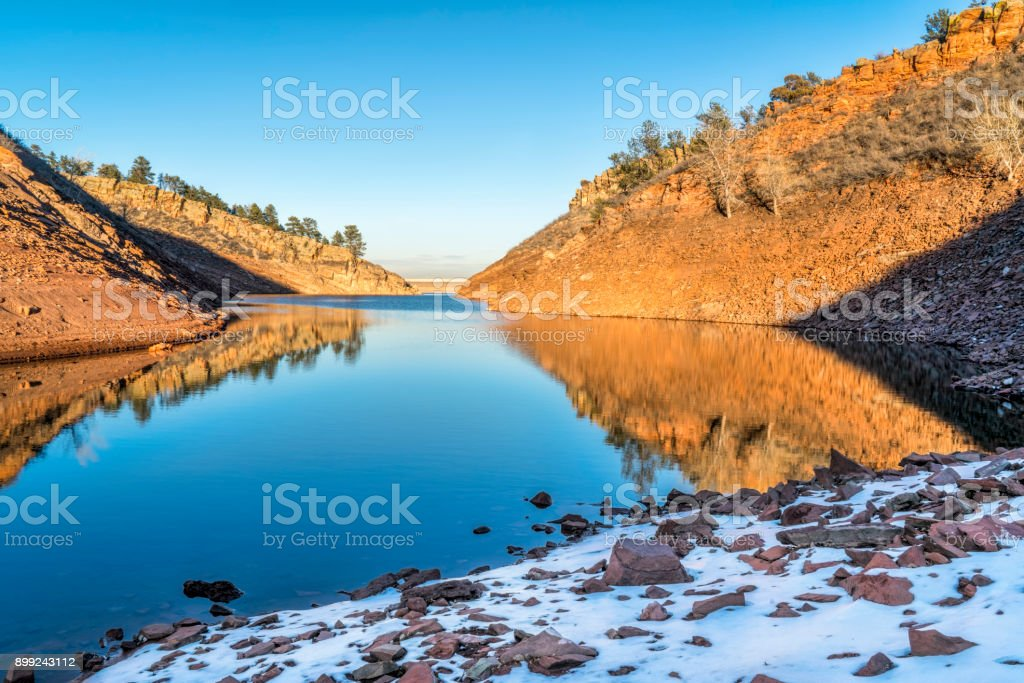 mountain lake in early winter scenery stock photo