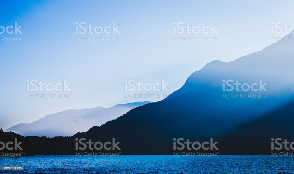 Mountain lake in morning hours stock photo