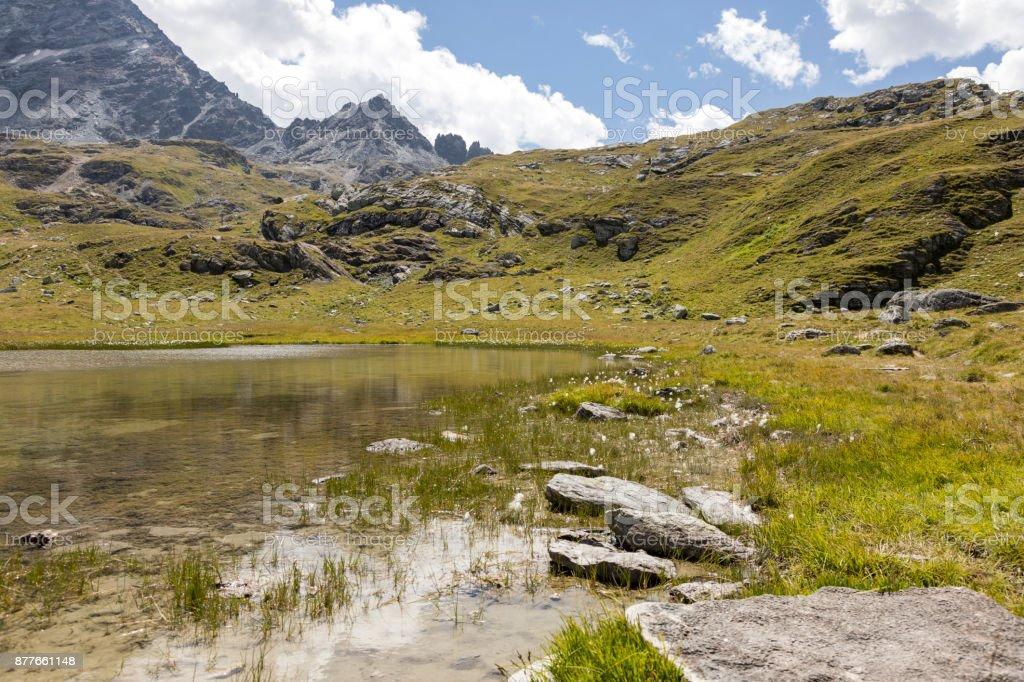 Mountain Lake in the valley of Engadin, Graubunden, Switzerland stock photo