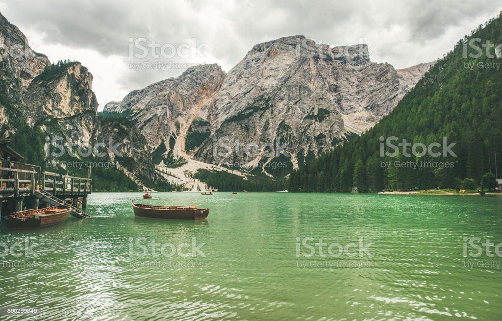 Mountain Lake in Valle di Braies and wooden boats stock photo