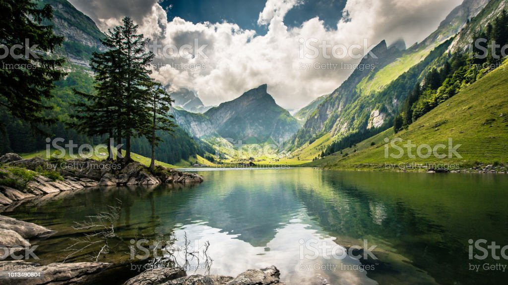 Mountain lake Seealpsee in Switzerland. Adventure Stock Photo