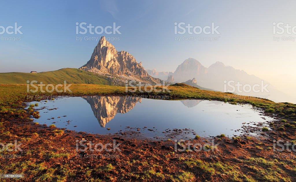 Mountain lake reflection, Dolomites, Passo Giau stock photo