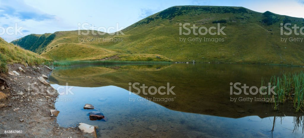 Mountain lake summer clean water stock photo