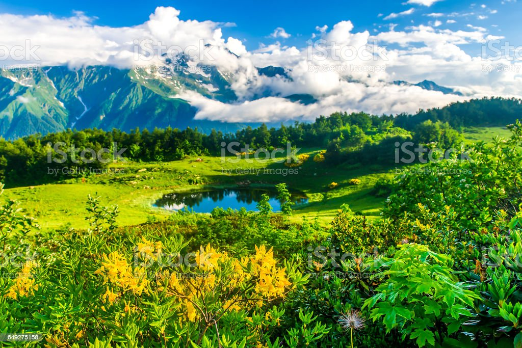 Mountain lake summer landscape clouds stock photo