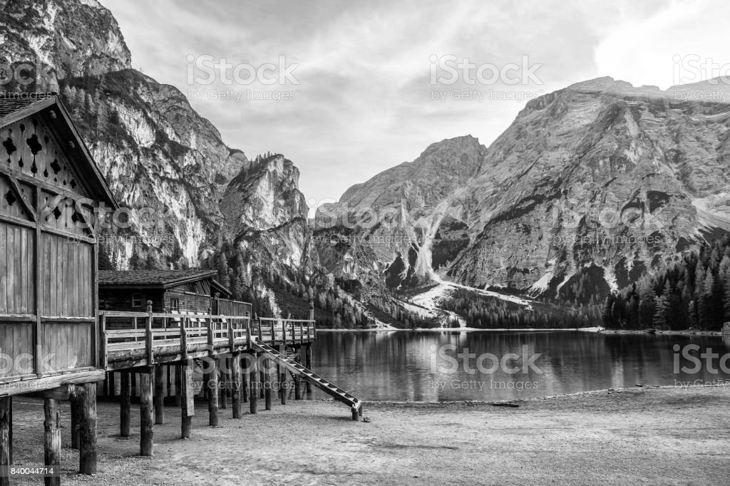 mountain lake with wooden house stock photo
