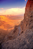 Mountain landscape. Desert in the early morning. Sunrise over the desert. Walkway to Masada Fortress, Israel