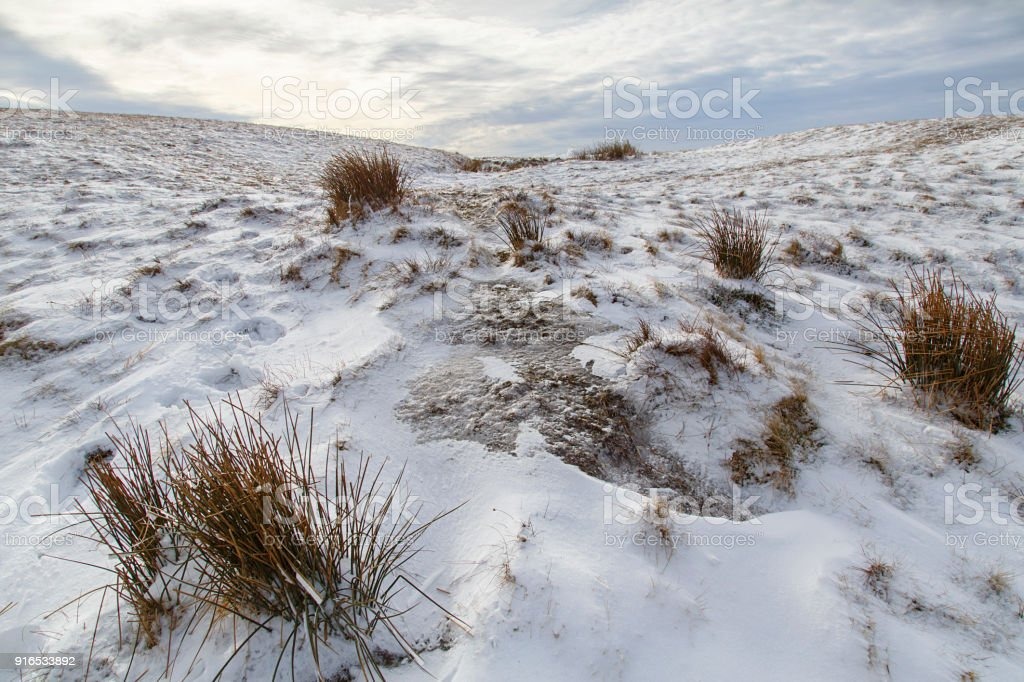 Mountain landscape in the Brecon Beacons National Park with winter snow stock photo