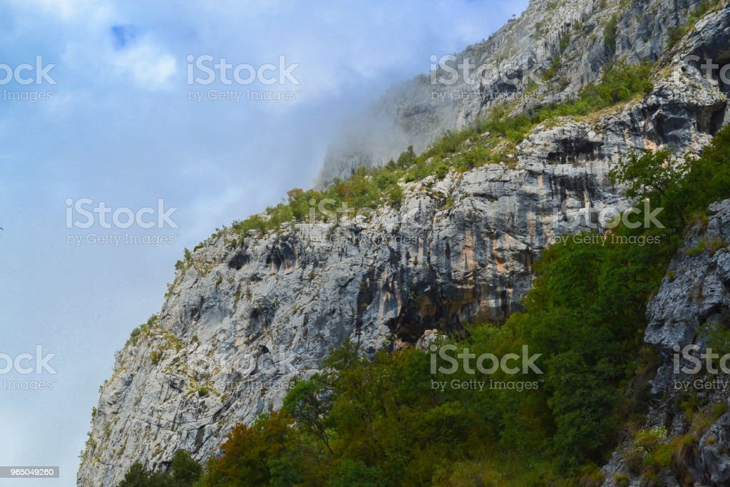 Mountain landscape. Mountains and clouds below the rocks. Montenegro zbiór zdjęć royalty-free