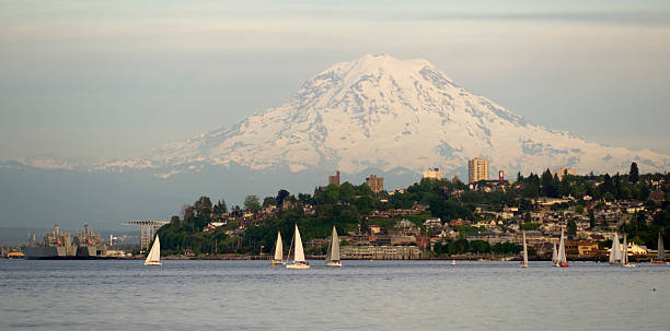 Mountain landscape of regatta commencement at Puget Sound Mt. Rainier looms large over north Tacoma and Sailboats Ruston Way waterfront tacoma stock pictures, royalty-free photos & images