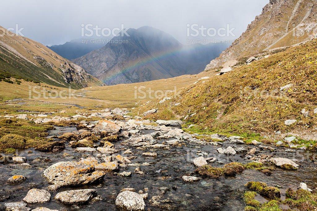 Mountain landscape of Tien Shan with rainbow. zbiór zdjęć royalty-free