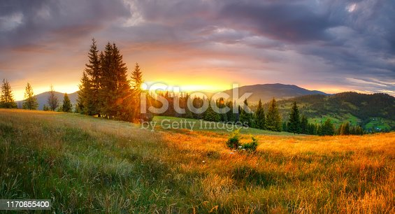 Autumn sunrise. Mountain landscape. Fall morning with vivid sky over beautiful valley. Tranquil background.