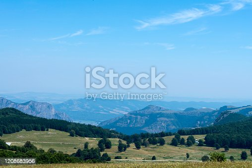 Mountain landscape. Scenic view, with depth, blue sky and mountain peaks