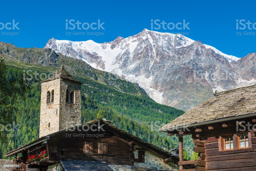 Mountain landscape. The Alps with Monte Rosa and the spectacular east wall of rock and ice from the picturesque alpine village of Macugnaga (Staffa) stock photo