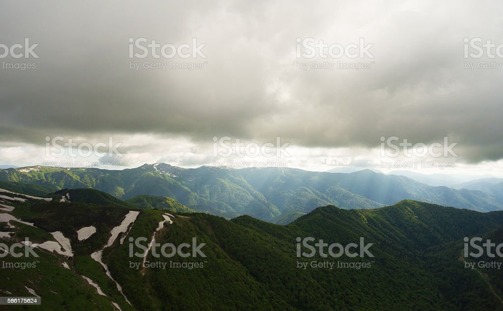 Mountain landscape. The road in the mountains covered by forest. stock photo
