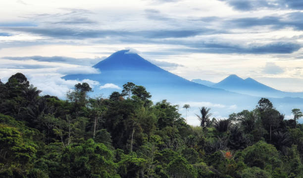 Mountain landscape view at Tomohon Tomohon, North Sulawesi, Indonesia - October 03, , Mountain landscape with Mount Lokon in Tomohon sulawesi stock pictures, royalty-free photos & images