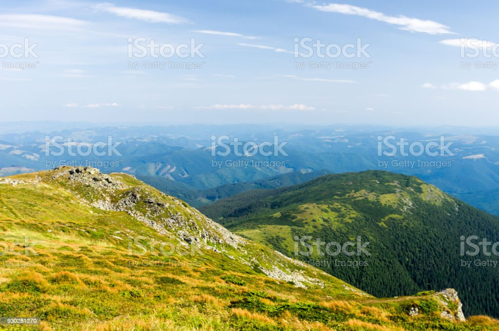 Mountain landscape with a foreground. Blue sky with clouds. stock photo