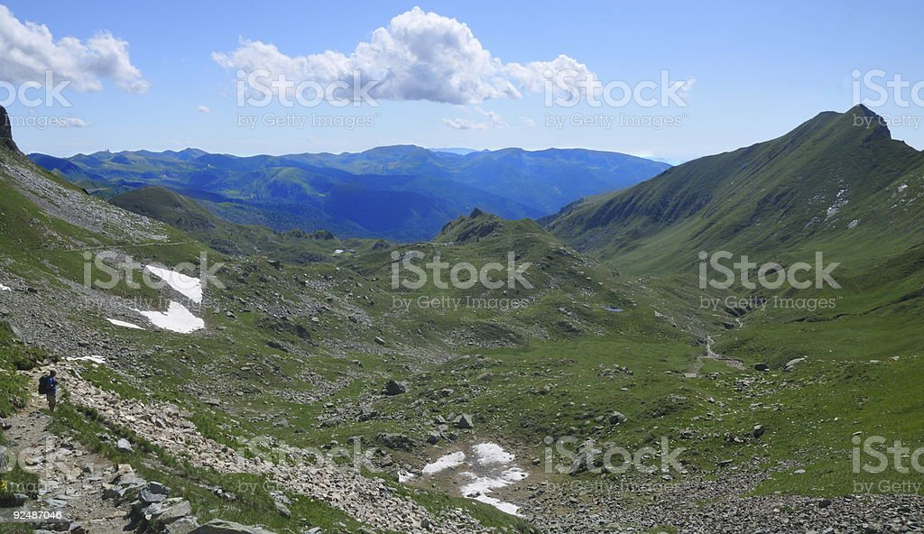 Mountain landscape with a male trekker royalty-free stock photo