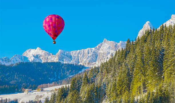 Mountain landscape with an air balloon stock photo