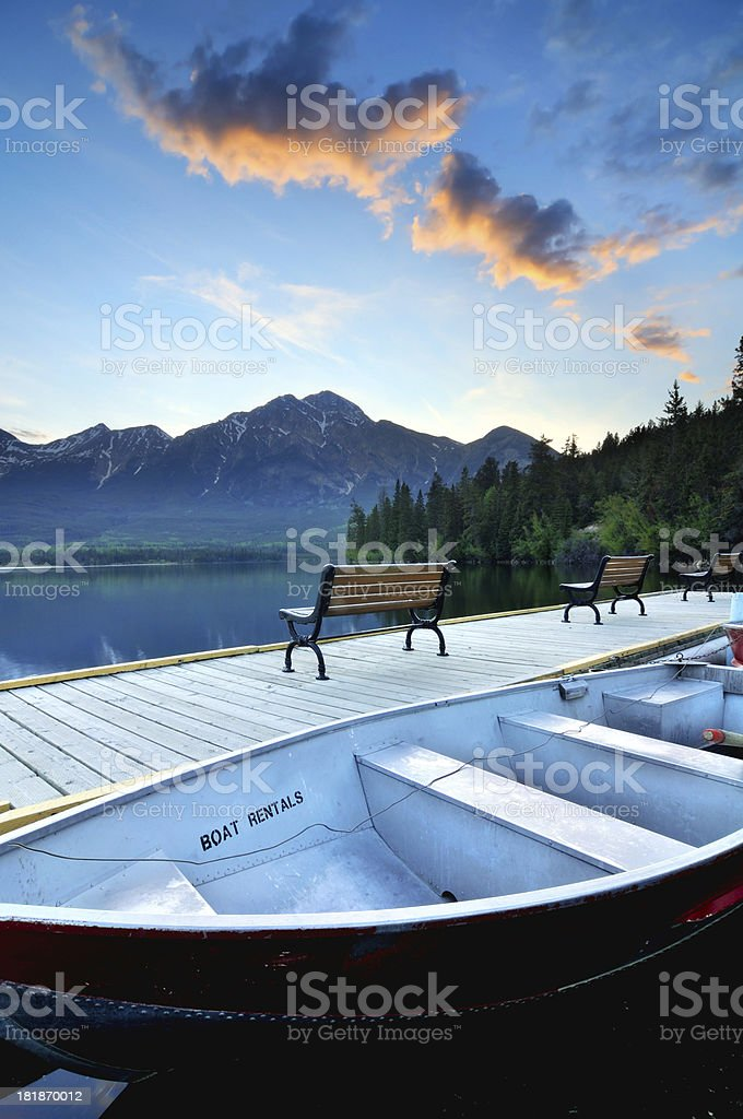 Mountain landscape with boat at Pyramid Lake, Canadian Rokies royalty-free stock photo
