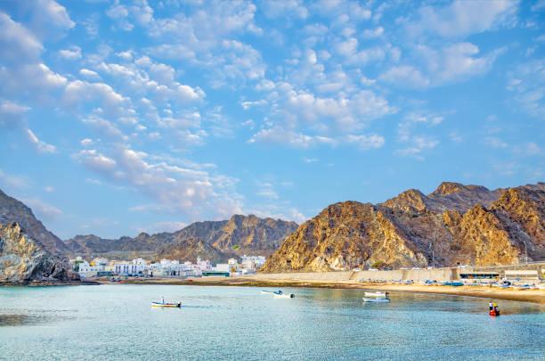 mountain landscape with calm sea - oman стоковые фото и изображения