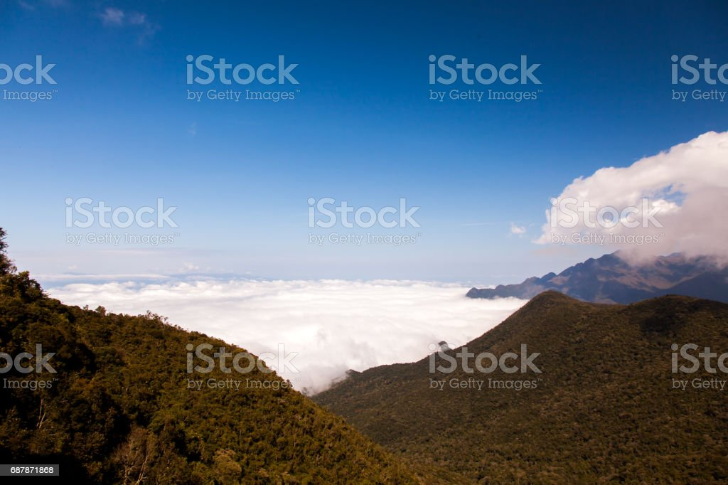 Mountain landscape with clouds below stock photo