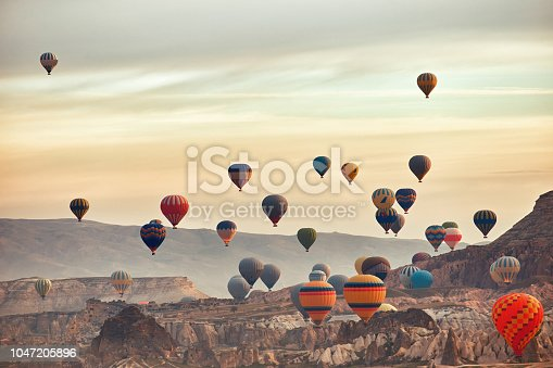 Beautiful balloons against the backdrop of a mountain landscape in the summer.