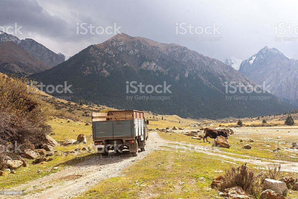Mountain landscape with old car of Tien Shan. zbiór zdjęć royalty-free