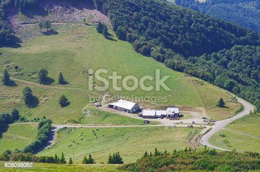 825525754 istock photo Mountain landscape with road and cottages.Village in mountain va 626099052
