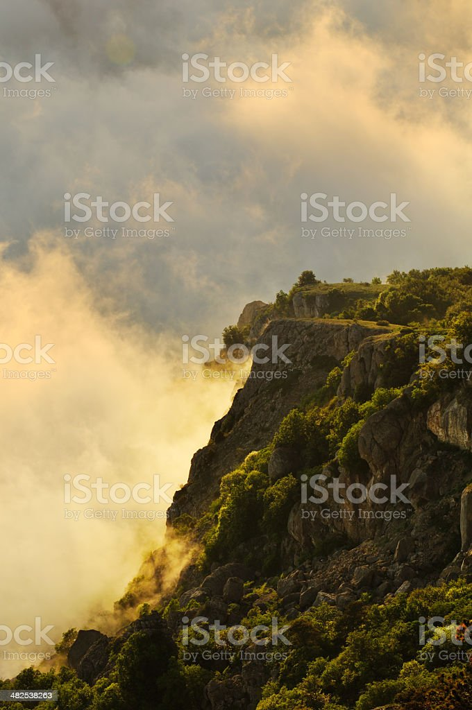 Mountain landscape with rocks and clouds stock photo