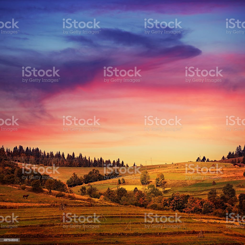 Mountain landscape with sunset sky and amazing clouds stock photo