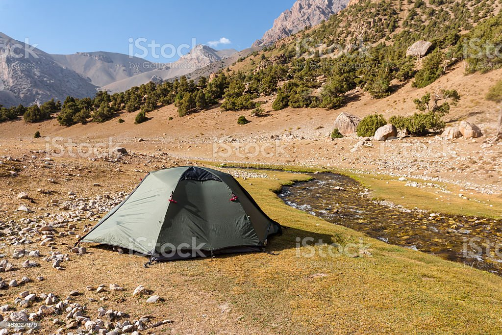 Mountain landscape with tents. stock photo