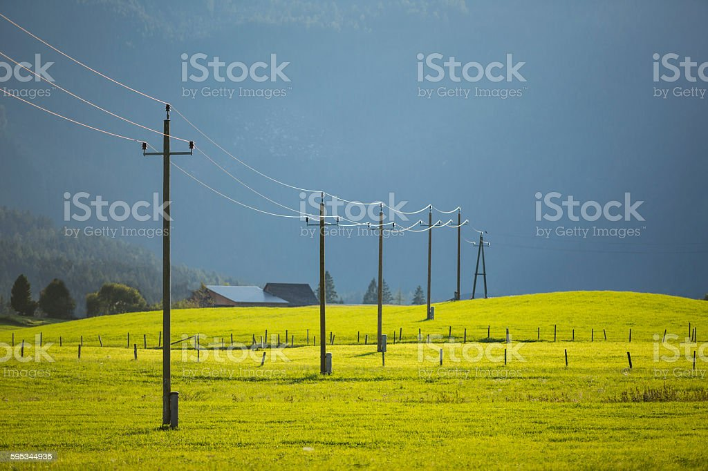 mountain landscape with the green meadow and power line – zdjęcie