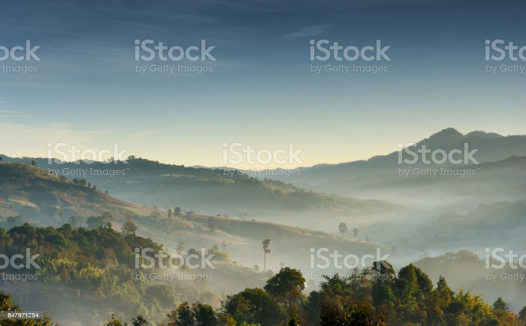 mountain layer with the slightly fog and the light in the morning stock photo