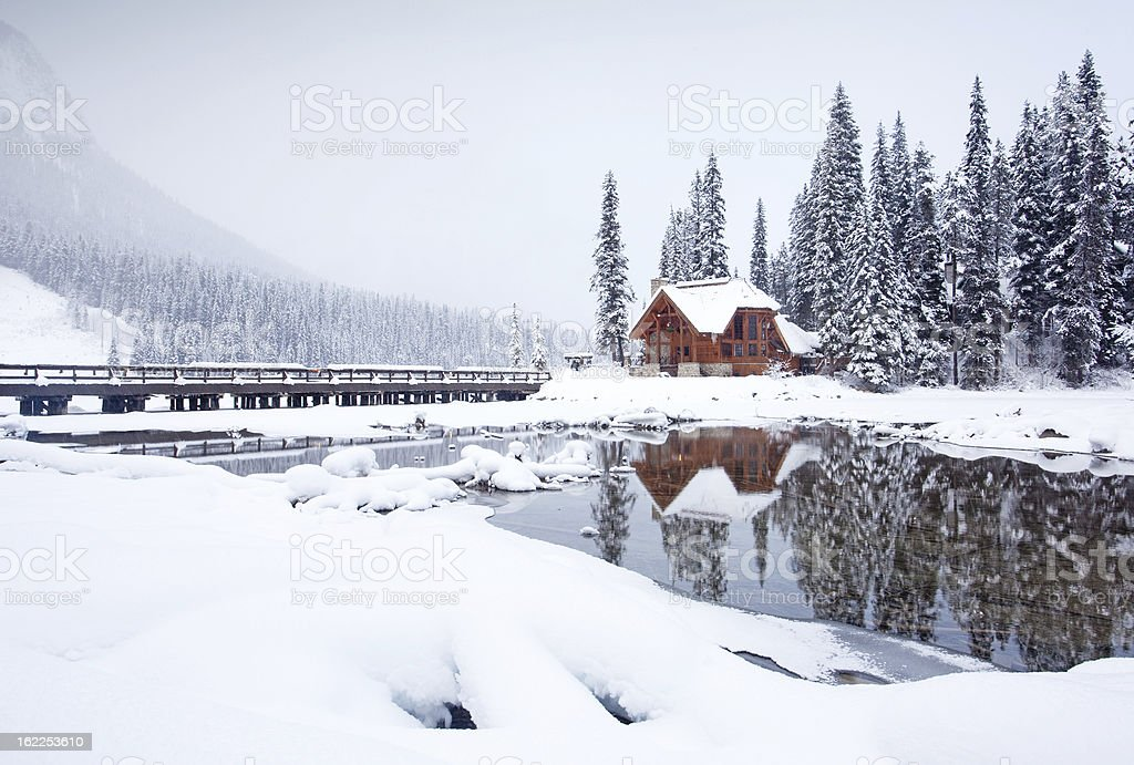 Mountain Lodge in Winter A winter scenic of a rustic, timber-framed lodge in the Canadian Rockies. Horizontal colour image. British Columbia, Canada. Rocky Mountains. Alberta Stock Photo