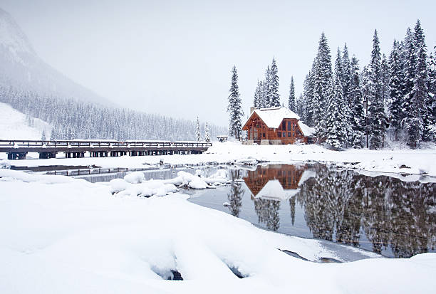 Mountain Lodge in Winter A winter scenic of a rustic, timber-framed lodge in the Canadian Rockies. Horizontal colour image. British Columbia, Canada. Rocky Mountains. emerald lake stock pictures, royalty-free photos & images