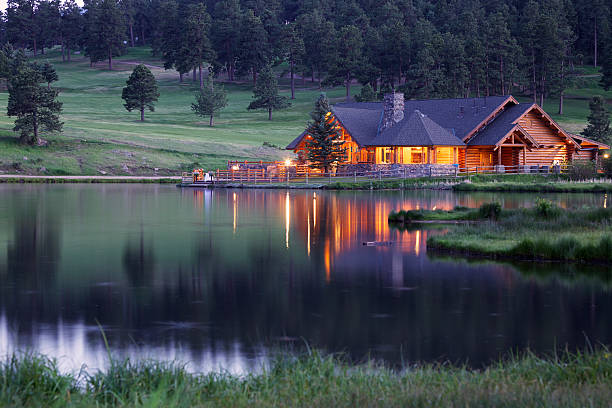 Mountain Lodge Reflecting in Lake at Dusk Mountain Lodge in Evergreen Colorado Reflecting in Lake at Dusk. This lodge is part of the public park area. rocky mountains north america stock pictures, royalty-free photos & images