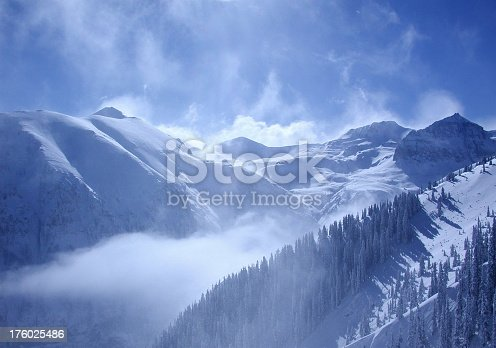 Mountains with rising mists in sunlight.